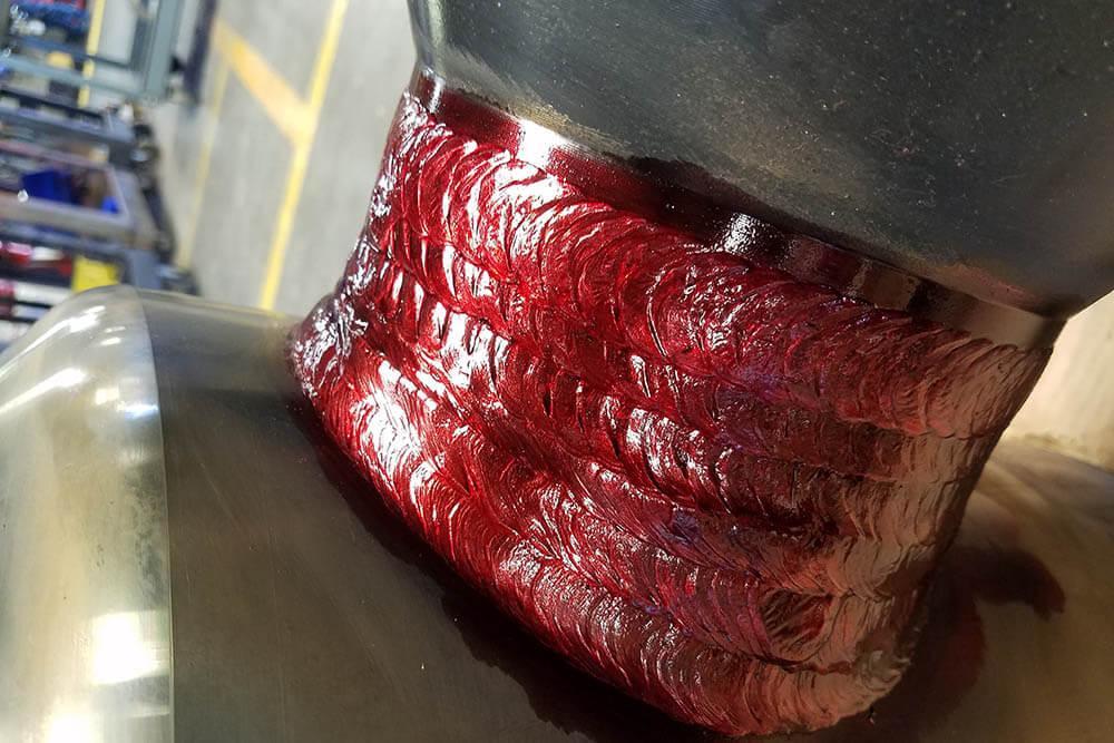 TXNDT liquid penetrant testing on a surface