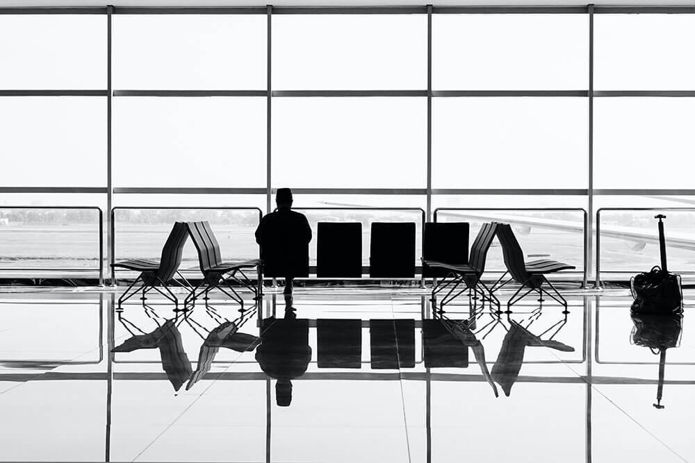 Man sitting in airport for travel