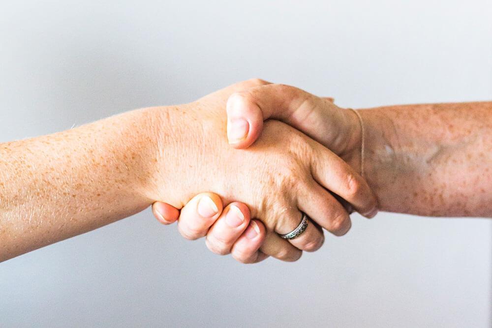 Two NDT contractors shaking hands