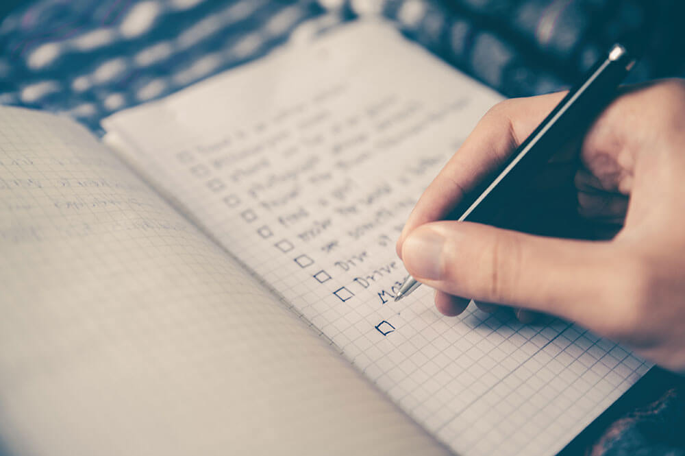 Person creating a checklist
