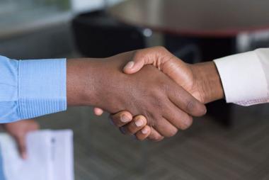 TXNDT contractors shaking hands in Houston