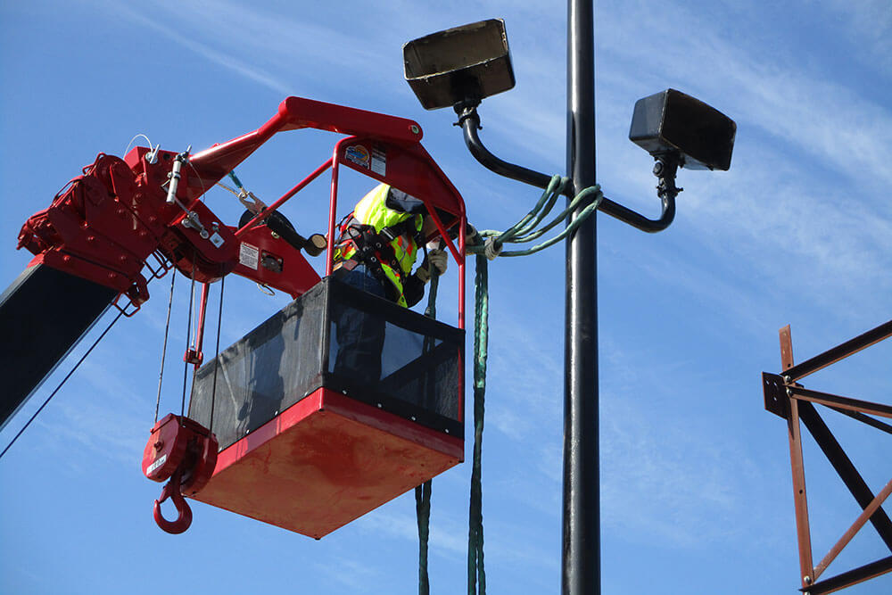 NDT technician looking at a light pole